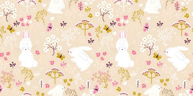 シームレスなパターンで柔らかいピンクの花とウサギのイラスト