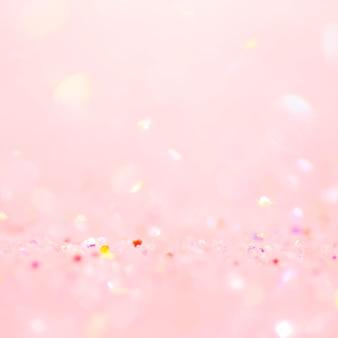 부드러운 분홍색 반짝이 색종이 bokeh 배경