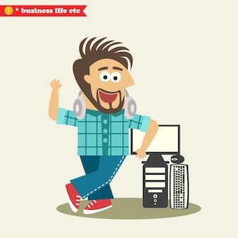 Ingegnere informatico che indossa le cuffie e il suo computer