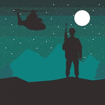 夜にライフルとヘリコプターのシルエットを持つ兵士