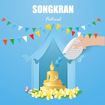 Концепция фестиваля сонгкран со статуей будды в голубом доме на фоне воды