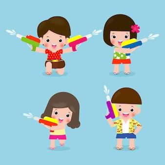 Songkran festival. set of kids holding water gun splashing water.