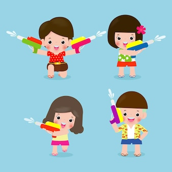 Фестиваль сонгкран. набор детей, держащих водяной пистолет брызг воды.