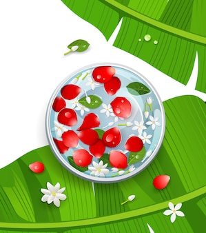 Songkran festival thailand rose petals and flower, leaf in water bowl on banana leaf