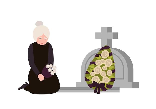 墓石と花輪で墓の近くで泣いている喪服を着た悲しい年配の女性。墓地や墓地で悲しんでいる悲しい未亡人。フラット漫画スタイルのカラフルなベクトルイラスト。