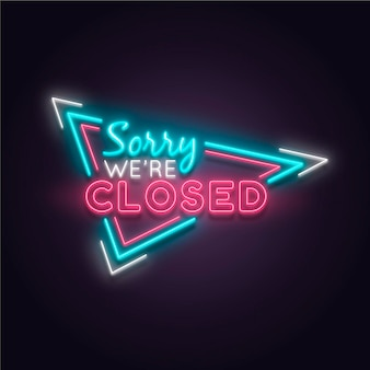 'sorry we are closed' sign on brick wall