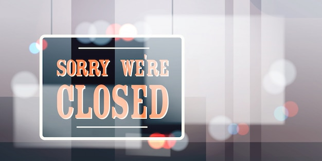 Sorry we are closed sign hanging outside business office store shop or restaurant