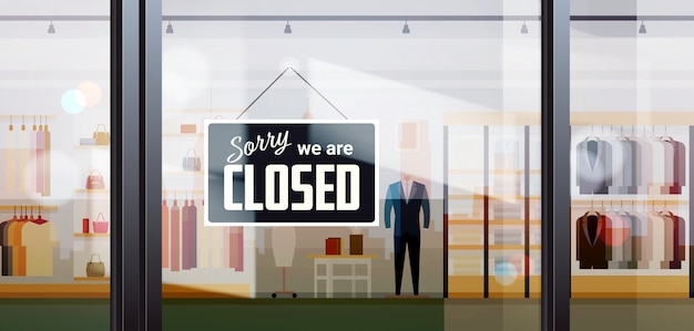 Sorry we are closed sign hanging outside male clothes shopping mall coronavirus pandemic quarantine