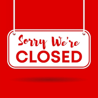Sorry we're closed door sign isolated on red background with shadow