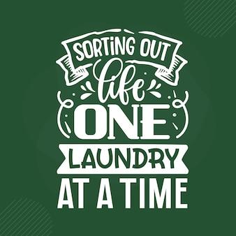 프리미엄 벡터 디자인 레터링 한 번에 인생 하나의 세탁물 분류