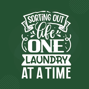 Sorting out life one laundry at a time lettering premium vector design