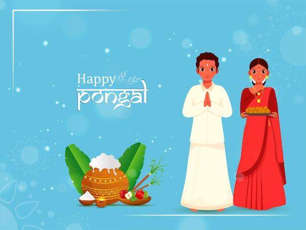 Южно-индийская пара приветствует индийское сладкое (laddu)