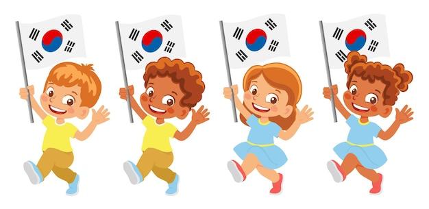 손에 한국 국기입니다. 깃발을 들고 있는 아이들. 대한민국의 국기