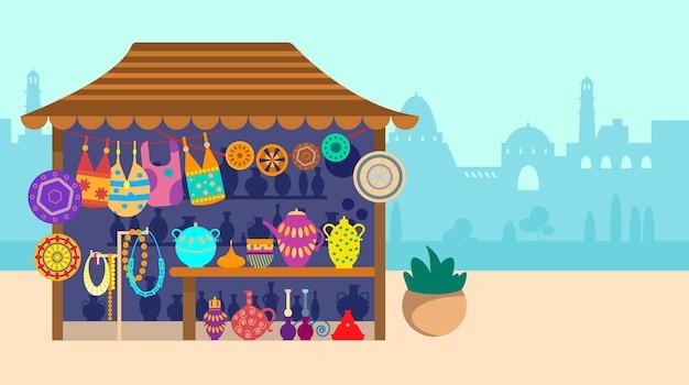 Сувенирная уличная лавка с городом на заднем плане керамические сумки и украшения