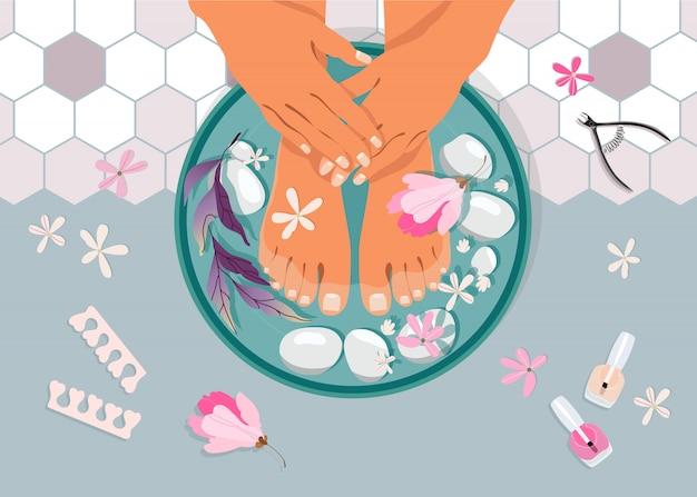 スパペディキュアの上面図。水を入れたボウルに女性の足。足と手のトリートメント。マニキュアとペディキュアの機器、スパの石と花。手描きのフェミニンなサロンデザイン。