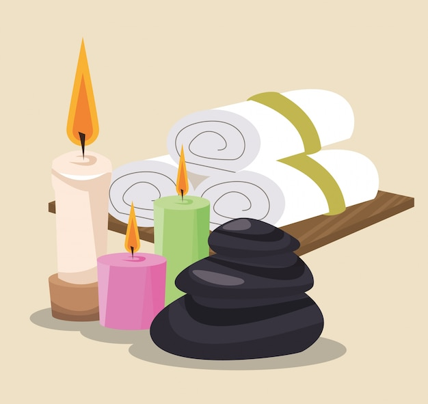 Spa stones candles and towel