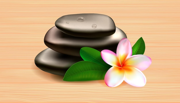 Spa stones with green leaves and tropical flower on wooden table against grey background