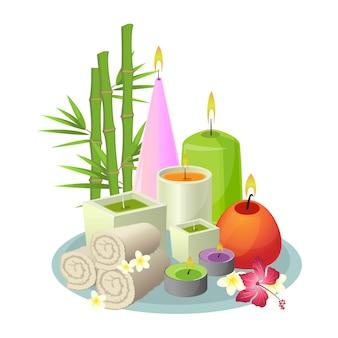 Набор для спа-процедур из белых свернутых полотенец, разноцветных свечей круглой и прямоугольной формы, тропических растений на сером подносе. коллекция вещей ароматерапии в восточном стиле на белом.