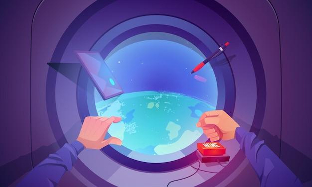 둥근 창문을 통해 지구를 볼 수 있는 우주선 내부. 과학 발견과 여행을 위한 셔틀 비행의 개념. 우주에서 로켓에 남자 손 푸시 홈 버튼의 벡터 만화 그림