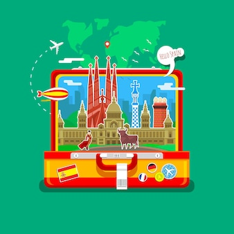 オープンスーツケースのランドマークとスペインの旗