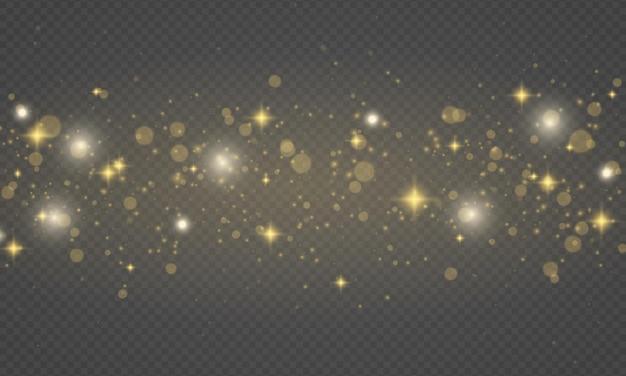 きらめく黄金の魔法のほこりの粒子がきらめく淡い黄色の火花星の輝きクリスマスの輝き