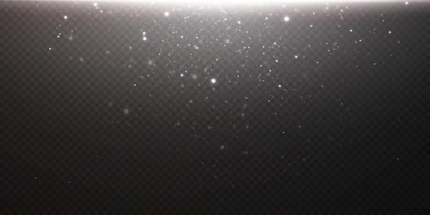 スパークリングマジックダスト。テクスチャの黒い背景に。小さなきらめくほこりの粒子や星からのお祝いの抽象的な背景。魔法効果お祭り