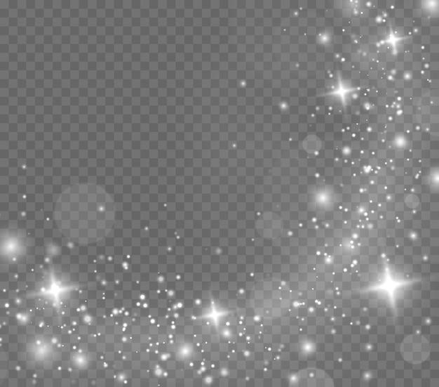 반짝이는 마법의 먼지 입자. 흰색 불꽃과 별이 반짝이는 특수 조명 효과.