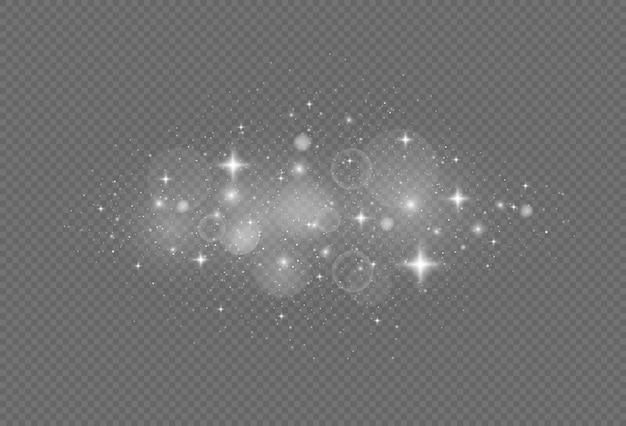 Сверкающие частицы волшебной пыли. белые искры и звезды сверкают особым световым эффектом.