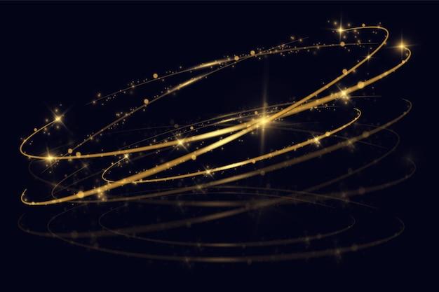 きらめく魔法のほこりの粒子。黄色いほこり黄色い火花と金色の星が特別な光で輝いています。ダイナミックなゴールデントレイル。クリスマスライト効果。黒の背景にきらびやかな明るいトレイル。