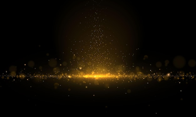 Sparkling magical dust and golden particles on black background. glitter and elegant . magic concept. abstract bokeh effect.