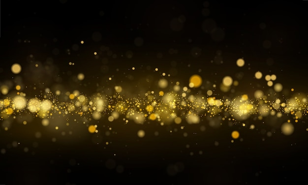 Sparkling magical dust and golden particles on black background.