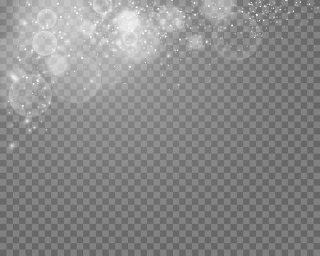 透明な背景に輝く魔法のほこりの粒子
