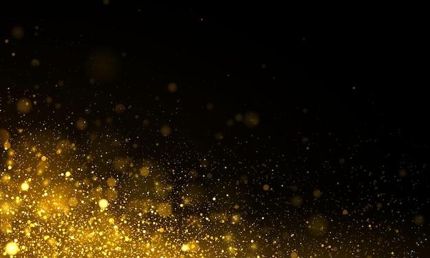 きらめく魔法の金黄色のほこりの粒子。ボケ効果。 Premiumベクター