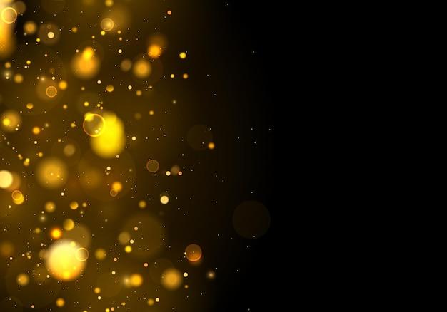 きらめく魔法の金黄色のほこりの粒子。ボケ効果。