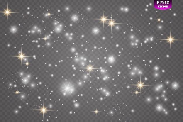 火花とキラキラの特別な光の効果。透明な背景の上で輝きます。輝く魔法の塵粒子