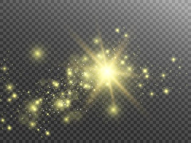 火花と金色の星が特別な光の効果を輝きます。透明な背景の上で輝きます。抽象的なパターン。輝く魔法の塵粒子