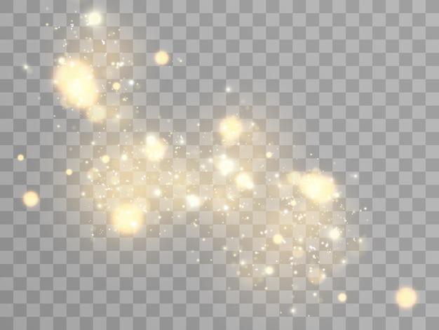 Искры и золотые звезды сверкают особым световым эффектом. блестки на прозрачном фоне. рождественский абстрактный узор. сверкающие частицы волшебной пыли.