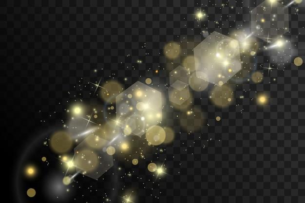火花と金色の星が特別な光の効果を輝かせます。透明な背景にきらめきます。きらめく魔法のほこりの粒子
