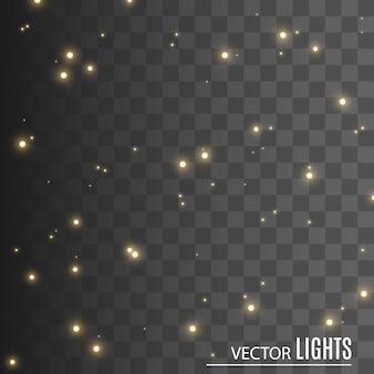 Искры и золотые звезды сверкают особым световым эффектом. блестки на прозрачном фоне. сверкающие частицы волшебной пыли