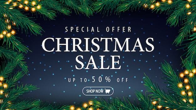 Special offer, christmas sale, up to 50% off, blue discount banner with blue starry sky, large title and frame og christmas tree branches and garlands
