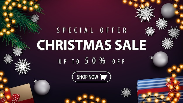 Special offer, christmas sale, up to 50% off, purple discount banner with garland, christmas tree branches, silver balls, presents and paper snowflakes, top view