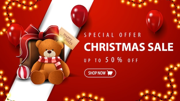 Special offer, christmas sale, up to 50 off, red discount banner with garland, red balloons and present with teddy bear