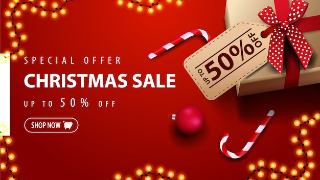 Special offer, christmas sale, up to 50% off, red discount banner with gift box, christmas balls and candy cane, top view