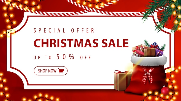 Special offer, christmas sale, up to 50% off, red discount banner with white paper sheet in the form of vintage ticket, christmas tree branches, garlands and santa claus bag with presents