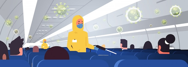 Specialists in hazmat suits cleaning and disinfecting airplane with passengers for epidemic  virus wuhan coronavirus  pandemic medical health risk concept plane interior horizontal