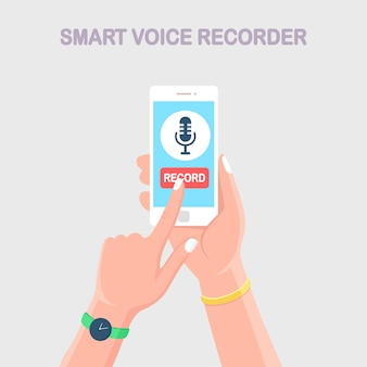 Speech voice recorder. hand hold mobile phone with microphone sign isolated on background.