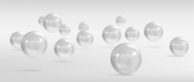 Spheres and balls on a grey background with a shadow.