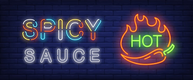 Spicy sauce, hot neon text with chili pepper and fire flames