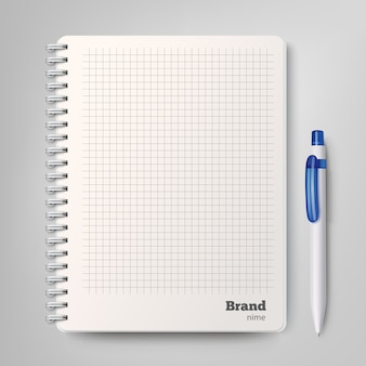 Spiral notebook with the white ballpoint pen.