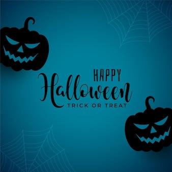Sfondo spettrale di halloween con zucche che ridono